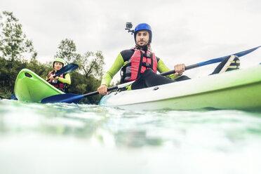 Germany, Bavaria, Allgaeu, couple kayaking on river Iller - PNPF00065