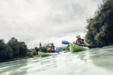 Germany, Bavaria, Allgaeu, couple kayaking on river Iller - PNPF00068