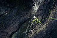 Germany, Bavaria, Allgaeu, young man canyoning in Ostertal - PNPF00071