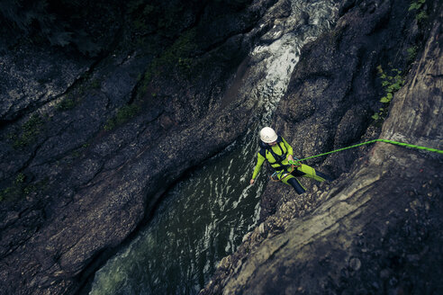 Germany, Bavaria, Allgaeu, young man canyoning in Ostertal - PNPF00071