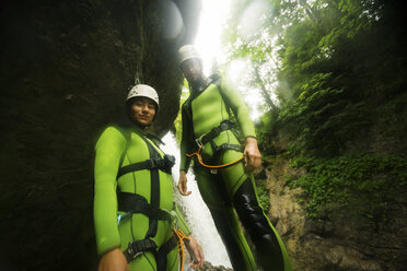 Germany, Bavaria, Allgaeu, young couple canyoning in Ostertal - PNPF00074
