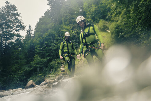 Germany, Bavaria, Allgaeu, young couple canyoning in Ostertal - PNPF00089