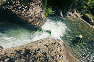 Germany, Bavaria, Allgaeu, couple canyoning in Ostertal - PNPF00092