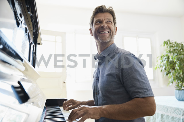 Mature man playing piano at home - PDF01340