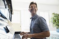 Mature man playing piano at home - PDF01340