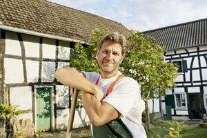 Mature man workingin his garden wearing apron - PDF01391