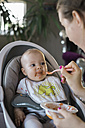 Mother feeding baby girl - MOMF00257