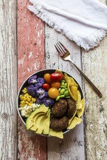 Quinoa veggie bowl of avocado, Edamame, tomatoes, corn, feta, nachos, cauliflower and quinoa fritters - SARF03377