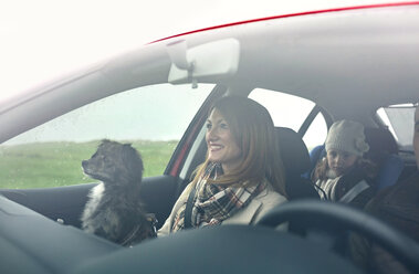 Happy family with small dog in car - DAPF00811