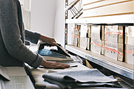 Close-up of tailor ironing - JUBF00275