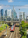 Germany, Frankfurt, view to central station with financial district in the background - AMF05474