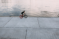 Young man riding fixie bike at the waterfront - VPIF00194