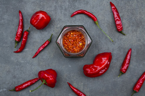 Various red chili pods and glass of chili flakes - LVF06314