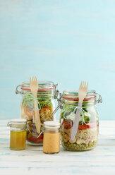 Preserving jars of various mixed salad and jars of salad dressings - ECF01896