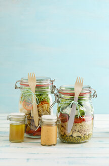 Preserving jars of various mixed salad and jars of salad dressings - ECF01896