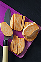 Sliced and sweet potato on chopping board - CSF28313