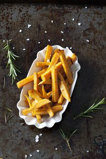 Sweet potato fries with rosmary and salt in porcelain bowl - CSF28325