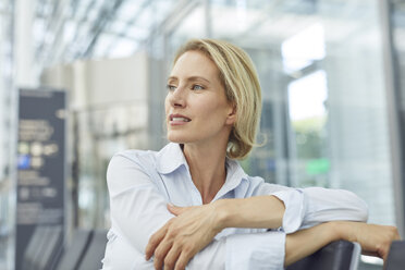 Portrait of businesswoman waiting at the airport - PNEF00031