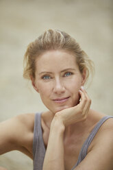 Portrait of smiling blond woman on the beach - PNEF00043