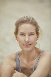 Portrait of smiling blond woman on the beach - PNEF00046