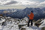 Austria, Tyrol, Oetztal, Soelden, woman with selfie stick at Gaislachkogel - GFF01026