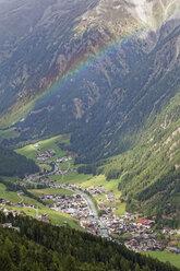Austria, Tyrol, Oetztal, rainbow above Soelden - GFF01035