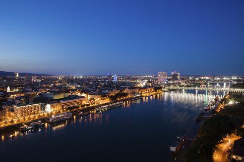 Slovakia, Bratislava, ight cityscape of the city at the Danube River - ABOF00274