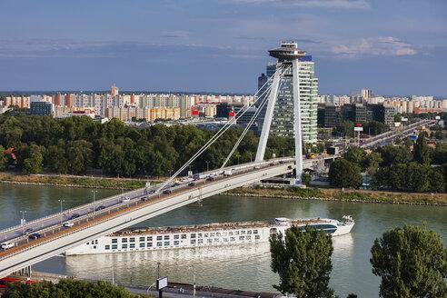 Slovakia, Bratislava, cityscape, Most SNP bridge and passenger boat on Danube River - ABOF00277