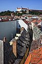 Slovakia, Bratislava, historic center, view over houses roofs towards Bratislava Castle - ABOF00289