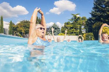 Group of seniors doing water gymnastics in pool - PNPF00107