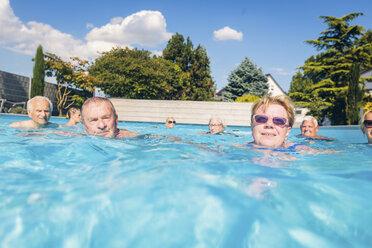 Group of seniors swimimng in swimming pool - PNPF00110