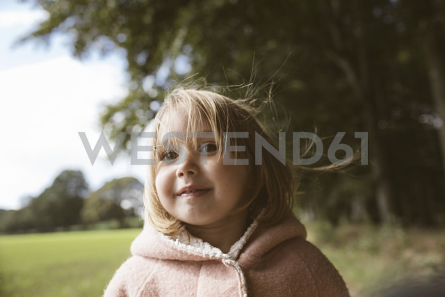 Portrait of blond little girl with blowing hair - KMKF00005