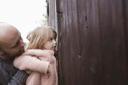 Curious little girl with father - KMKF00014
