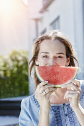 Portrait of happy woman with slice of watermelon outdoors - RORF01047