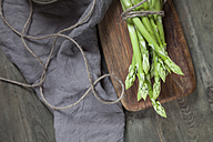 Bunch of green asparagus on wooden board - SBDF03311