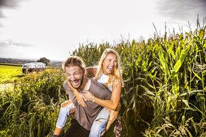 Carefree couple in cornfield - FMKF04570