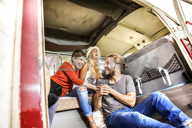 Carefree friends inside a van - FMKF04585