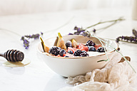 Bowl of Greek yoghurt with fig, watermelon, frozen berries and lavender honey - SBDF03323