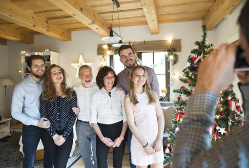 Family posing for a photo at Christmas tree - HAPF02172