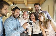 Laughing family looking at camera - HAPF02175