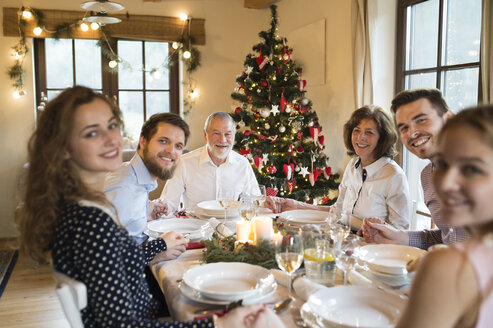 Happy family at Christmas dinner table - HAPF02190