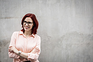 Portrait of a young businesswoman with wristwatch - JUNF00981