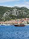 Croatia, Adriatic coast, Dalmatia, Hvar, coastal town and traditional ship - AMF05494