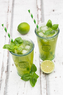 Two glasses of organic lime lemonade with basil - LVF06335