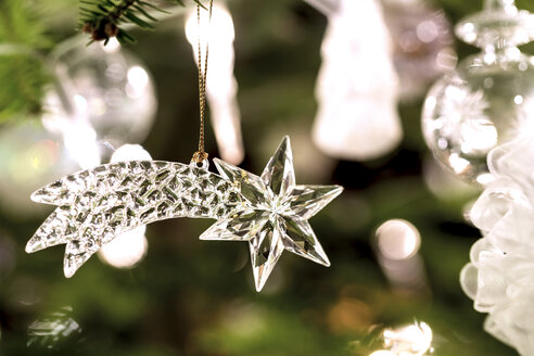 Fir branch with transparent Christmas decoration - PUF00781