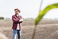 Portrait of confident farmer on field - UUF11911