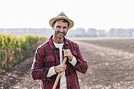 Portrait of confident farmer on field - UUF11914