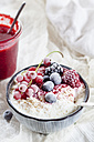 Bowl of natural yoghurt with raspberry sauce and frozen fruits - SBDF03328