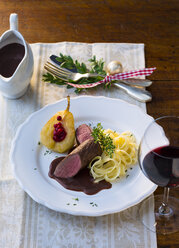 Plate of venison filet with ribbon noodles, stuffed pear and red wine sauce - PPXF00095