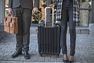 Businessman and businesswoman standing with luggage - ZEF14649